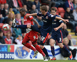 Leyton Orient's Kevin Lisbie and Walsall's Paul Downing compete for the ball   - Photo mandatory by-line: Mitchell Gunn/JMP - Tel: Mobile: 07966 386802 29/09/2013 - SPORT - FOOTBALL -  Matchroom Stadium - London - Leyton Orient v Walsall - Sky Bet League One