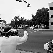 Daly often waves to the drivers of vehicles as they pass him by on the streets.