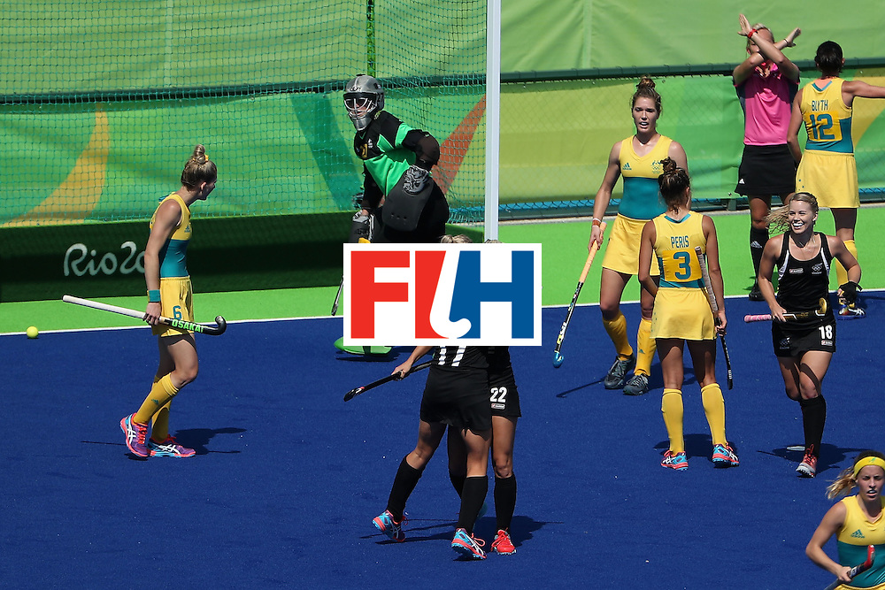 RIO DE JANEIRO, BRAZIL - AUGUST 15: Gemma Flynn #22 and Sophie Cocks #17 of New Zealand celebrate after Flynn scored a goal past goalkeeper Rachael Lynch #27 of Australia during the quarter final hockey game on Day 10 of the Rio 2016 Olympic Games at the Olympic Hockey Centre on August 15, 2016 in Rio de Janeiro, Brazil.  (Photo by Christian Petersen/Getty Images)