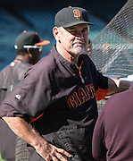 Bruce Bochy is chatting with Jon Miller, during batting practice prior to the MLB game between the San Francisco Giants and the Colorado Rockies, at AT&amp;T Park in San Francisco, CA.<br /> The Rockies won 8-6 in 9 innings.<br /> Credit : Glenn Gervot