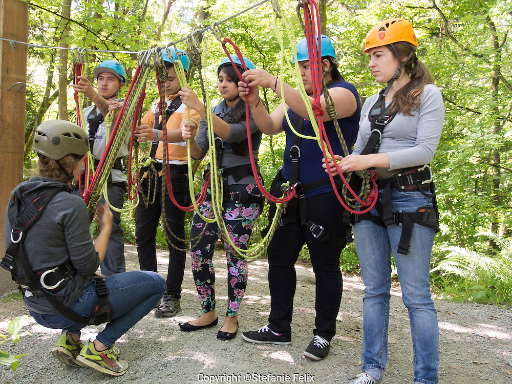 High School ELL students receive training for a ropes course during a  mountaineering field trip