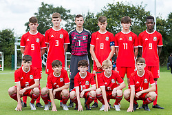 WREXHAM, WALES - Tuesday, August 13, 2019: Wales' players line-up for a team group photograph before the UEFA Under-15's Development Tournament match between Wales and Cyprus at Colliers Park. Back row L-R: Ethan Hartness, Rueben Evans, goalkeeper Oliver Camis, captain Ben Lloyd, Finlay Corrigan, Japhet Matondo. Front row L-R: Alex Williams, Calum Agius , Ethan Simpson, Daniel Watts, Jonathan Bland. (Pic by Paul Greenwood/Propaganda)