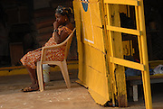 A woman waits for customers, Hohoe, Ghana