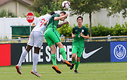 Canada forward Hugo Mbongue (9) and Slovenia defender Srdan Kuzmic (4) vie for a header during a CONCACAF boys under-15 championship soccer game, Saturday, August 10, 2019, in Bradenton, Fla. Slovenia defeated Canada in 2-1 in overtime and advanced to the finals against Portugal. (Kim Hukari/Image of Sport)