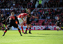 Swindon Town's Andy Williams sees his header saved - Photo mandatory by-line: Joe Meredith/JMP - Tel: Mobile: 07966 386802 04/05/2013 - SPORT - FOOTBALL - County Ground - Swindon - Swindon Town v Brentford - Npower League one Play Off