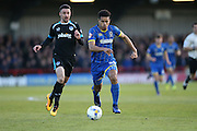 AFC Wimbledon striker Lyle Taylor (33) and Portsmouth defender Christian Burgess (6) during the Sky Bet League 2 match between AFC Wimbledon and Portsmouth at the Cherry Red Records Stadium, Kingston, England on 26 April 2016.
