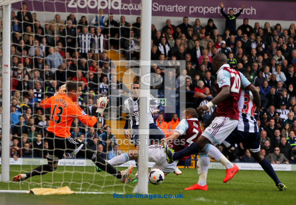 Morgan Amalfitano (centre) of West Bromwich Albion sets up his sides first goal scored by Saido Berahino (right) of West Bromwich Albion during the Barclays Premier League match at The Hawthorns, West Bromwich<br /> Picture by Tom Smith/Focus Images Ltd 07545141164<br /> 26/04/2014