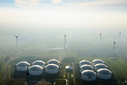 Nederland, Groningen, Gemeente Eemsmond, 04-11-2018; Vopak Terminal Eemshaven, opslag van ruwe olie en olieproducten. Omgeven door windmolens.<br /> Vopak Terminal Eemshaven, storage of crude oil and oil products.<br /> luchtfoto (toeslag op standaard tarieven);<br /> aerial photo (additional fee required);<br /> copyright © foto/photo Siebe Swart