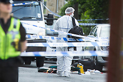 © Licensed to London News Pictures. 16/06/2016. Leeds, UK. Police are at the scene in Birstall, south of Leeds, where Jo Cox, Member of Parliament for Batley and Spen, has been shot and stabbed during a constituency surgery. Photo credit: Andrew McCaren/LNP