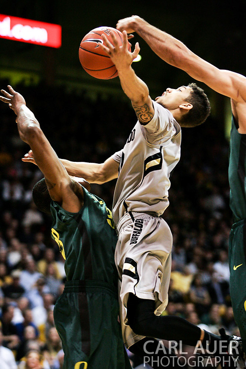 March 3, 2013: Boulder, Colorado - Colorado Buffaloes sophomore guard Askia Booker (0) attempts a lay up in the Colorado Buffaloes game against the University of Oregon Ducks at the Coors Events Center