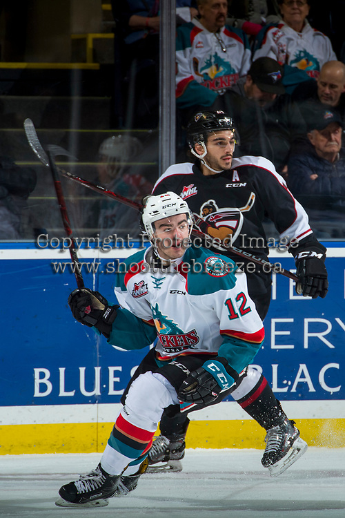 KELOWNA, CANADA - MARCH 7: Erik Gardiner #12 of the Kelowna Rockets looks for the pass ahead of Matt Barberis #24 of the Vancouver Giants on March 7, 2018 at Prospera Place in Kelowna, British Columbia, Canada.  (Photo by Marissa Baecker/Shoot the Breeze)  *** Local Caption ***