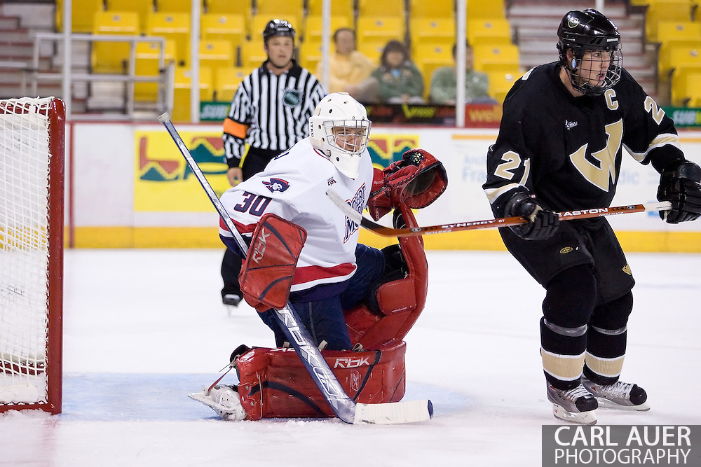 October 13, 2007 - Anchorage, Alaska:  Goalie Wes Russell (30) of the Robert Morris Colonials sets up for a shot as Mike Forgie (21) of the Wayne State Warriors looks for a pass during the Colonials 4-1 win over Wayne State in the 3rd game of the Nye Frontier Classic at the Sullivan Arena.  RMU would go on to be the Classic Champions after host Alaska-Anchorage tied with Boston University in the 4th game of the Classic.