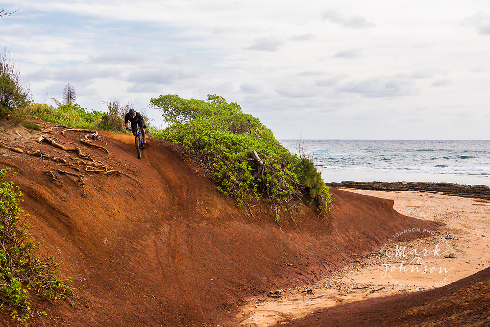 Mountain biking along the coast of Kauai, Hawaii