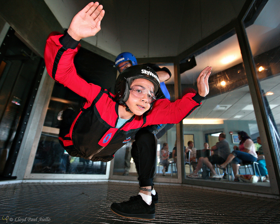 "AJ (age 12) ""Skydiving"" with the instructor in the wind tunnel, Sky Ventures, Nashua, New Hampshire."