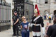 14 June 2017 - Tourists pose with guards as armed police watch on.