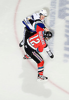 KELOWNA, CANADA, DECEMBER 2: Tyrell Goulbourne #12 of the Kelowna Rockets gets in the face of Jesse Zgraggen #6 of the Victoria Royals as the Victoria Royals visit the Kelowna Rockets  on December 2, 2011 at Prospera Place in Kelowna, British Columbia, Canada (Photo by Marissa Baecker/Shoot the Breeze) *** Local Caption ***
