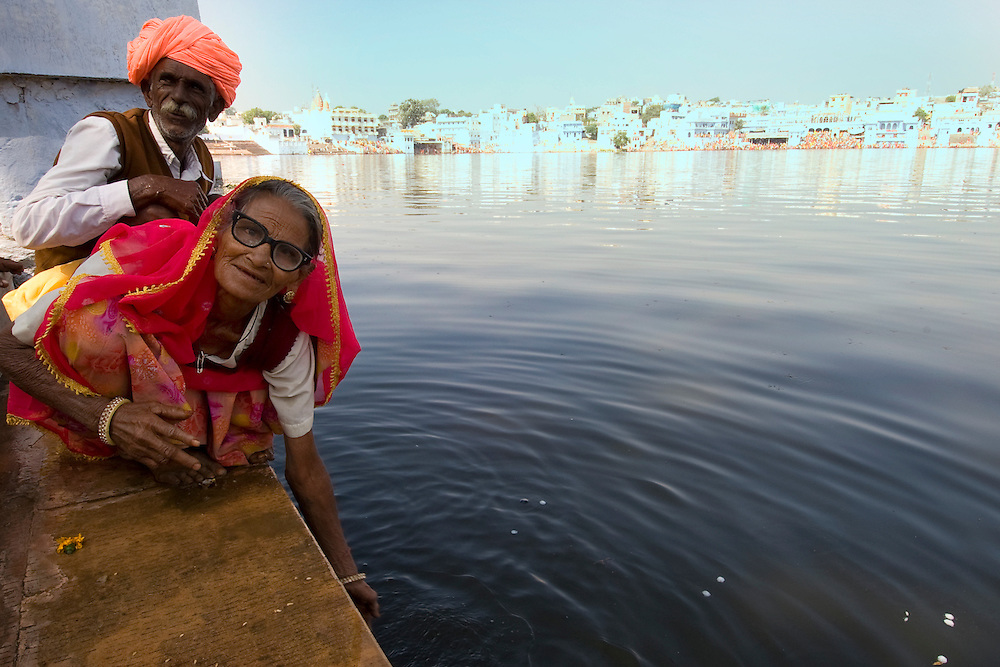 The lake at Pushkar is considered a very holy place by many locals and pilgrims who perform prayers and bath in the water.