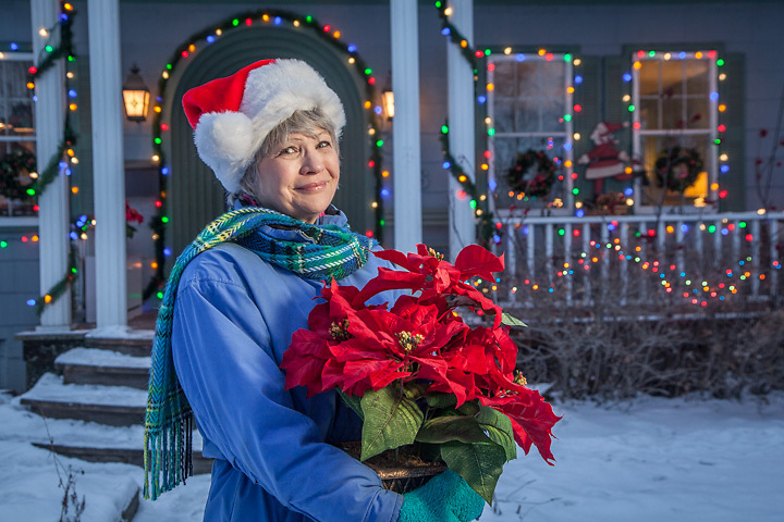 Lani Brennan on Christmas Eve in front of her home on G Street in Anchorage's South Addition neighborhood.