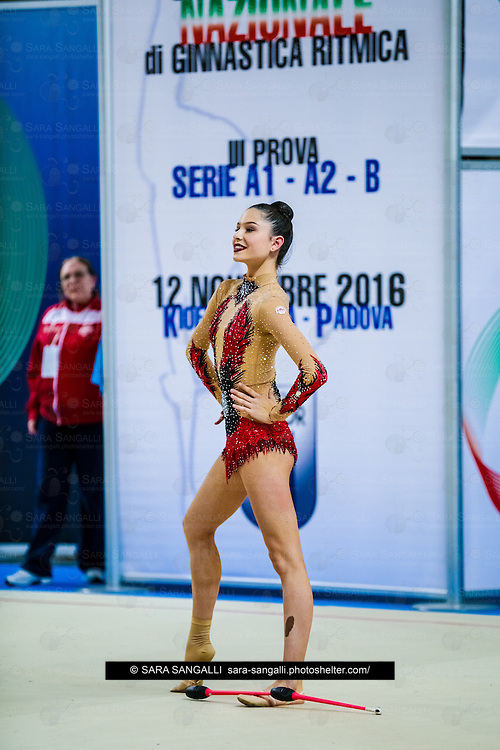 PADUA, ITALY - NOVEMBER 12 2016: Milena Baldassarri of Fabriano performs with clubs at the italian national rhythmic gymnastic championship. Her score in the apparatus is 17,250. Her team's score is 101,250 and ended up in second position.<br /> #SerieAdiritmica<br /> #ginnasticaritmica #rhythmicgymnastic #gymnast #sport #sportphotography