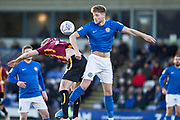 Bradford City midfielder Chris Taylor and Macclesfield Town defender Fraser Horsfall both jump for the ballduring the EFL Sky Bet League 2 match between Macclesfield Town and Bradford City at Moss Rose, Macclesfield, United Kingdom on 30 November 2019.