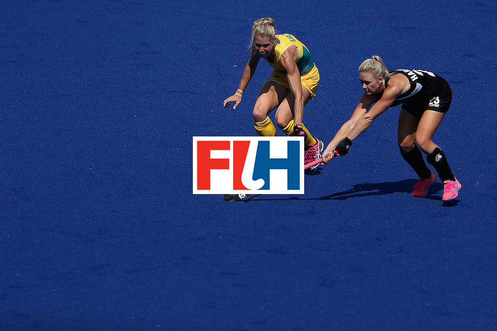 RIO DE JANEIRO, BRAZIL - AUGUST 15:  Casey Sablowski #4 of Australia and Charlotte Harrison #23 of New Zealand reach for a loose ball during the second half of the quarter final hockey game on Day 10 of the Rio 2016 Olympic Games at the Olympic Hockey Centre on August 15, 2016 in Rio de Janeiro, Brazil.  (Photo by Christian Petersen/Getty Images)