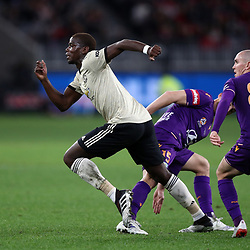 Paul Pogba of Manchester United breaks from Brandon Wilson of Perth Glory