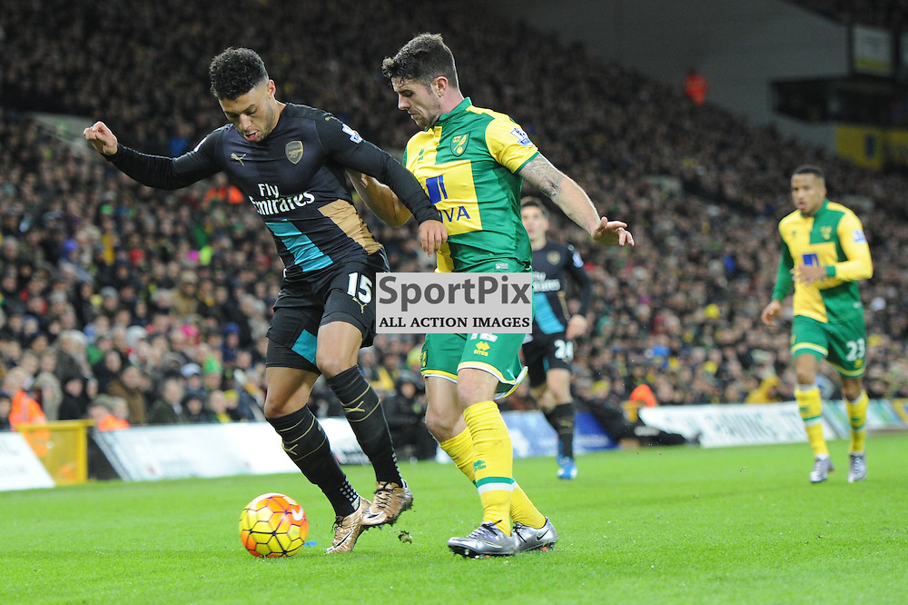 Norwichs Robbie Brady and Arsenals Alex Oxlade Chamberlain in action during the Norwich v Arsenal game in the Barclays Premier League on Sunday 29th November 2015 at Carrow Road