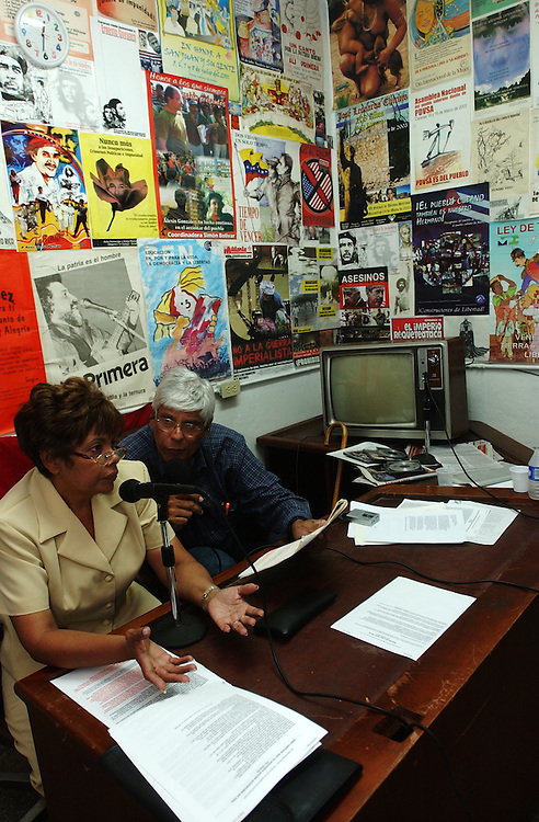 "Jose Ovalles,right, and Elida Polanco co-host the radio program ""Searching for America"" on Radion Perola, a community radio station in western Caracas.  This episode of the show was mostly focused on pro-Chavez and anti-US rhetoric.  Chavez and his government have been increasingly supportive of these generally Chavista community media stations as a response to the anti-chavista private media."