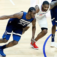 06 December 2017: Minnesota Timberwolves forward Andrew Wiggins (22) drives past LA Clippers guard Sindarius Thornwell (0) on a screen set by Minnesota Timberwolves guard Jamal Crawford (11) during the Minnesota Timberwolves 113-107 victory over the LA Clippers, at the Staples Center, Los Angeles, California, USA.
