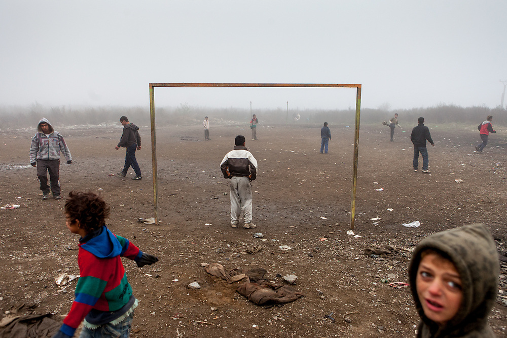 Young boys playing on a football pitch in the Roma settlement located in 'Budulovska street' in Moldava nad Bodvou (2012). The city has roughly 11200 inhabitants, about 1980 (18%) of them have Roma ethnicity and around 800 are living at the segregated settlement 'Budulovska Street' (2014).