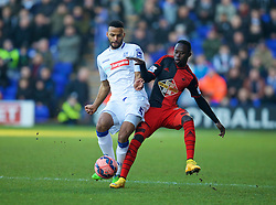 BIRKENHEAD, ENGLAND - Saturday, January 3, 2015: Tranmere Rovers' Michael Ihiekwe in action against Swansea City's Mo Barrow during the FA Cup 3rd Round match at Prenton Park. (Pic by David Rawcliffe/Propaganda)
