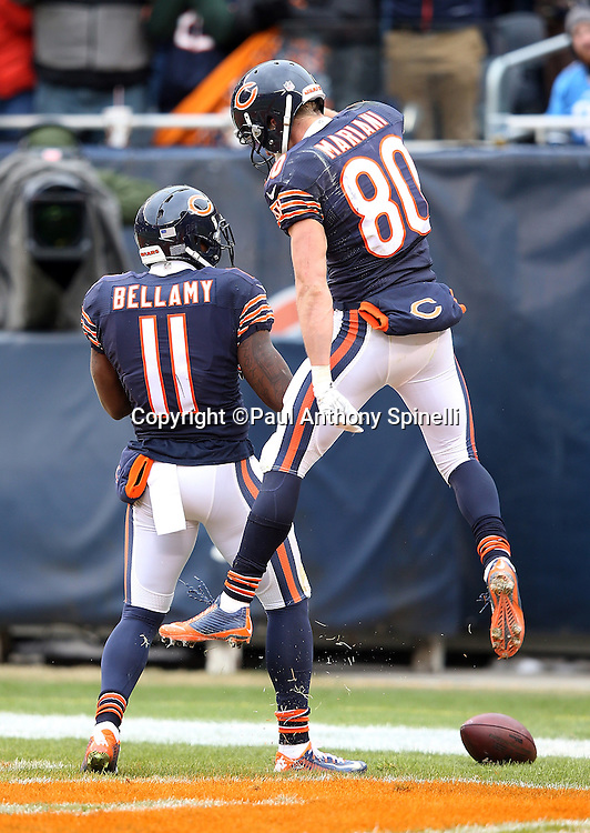 Chicago Bears wide receiver Marc Mariani (80) leaps and celebrates with Chicago Bears wide receiver Josh Bellamy (11) after Bellamy catches a 34 yard touchdown pass in the end zone that ties the third quarter score at 10-10 during the NFL week 17 regular season football game against the Detroit Lions on Sunday, Jan. 3, 2016 in Chicago. The Lions won the game 24-20. (©Paul Anthony Spinelli)