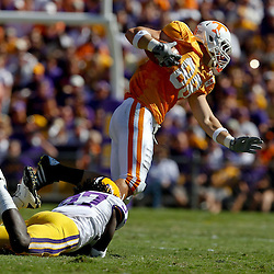 Oct 2, 2010; Baton Rouge, LA, USA; Tennessee Volunteers tight end Luke Stocker (88) is tackled by LSU Tigers safety Karnell Hatcher (37) during the first half at Tiger Stadium.  Mandatory Credit: Derick E. Hingle