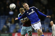 Scott Arfield of Burnley and Lex Immers of Cardiff City challenge for a high ball during the Sky Bet Championship match between Burnley and Cardiff City at Turf Moor, Burnley, England on 5 April 2016. Photo by Simon Brady.