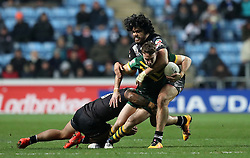 Australia's James Malony is tackled by New Zealand Manu Ma'u (left) and Tohu Harris during the Four Nations match at the Ricoh Arena, Coventry.
