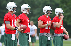 June 14, 2012; Florham Park, NJ, USA; (L to R) New York Jets quarterbacks Greg McElroy (14), Mark Sanchez (6), Tim Tebow (15) and Matt Simms (9) during New York Jets Minicamp at the Atlantic Health Training Center.