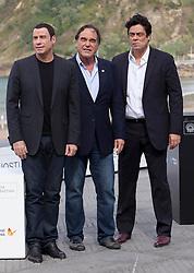 Benicio del Toro,  Oliver Stone and  John Travolta at the San Sebastian Film Festival, Sunday, 23rd September 2012 . SPAIN OUT. Photo by : Nacho Lopez / DyD Fotografos / i-Images