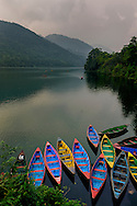 A general view of colorful canoe on pokhara lake, nepal