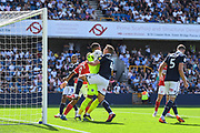 Millwall Goalkeeper Jordan Archer (1) and Millwall Defender Shaun Hutchinson (4) clash as the ball is collected during the EFL Sky Bet Championship match between Millwall and Middlesbrough at The Den, London, England on 4 August 2018. Picture by Stephen Wright.