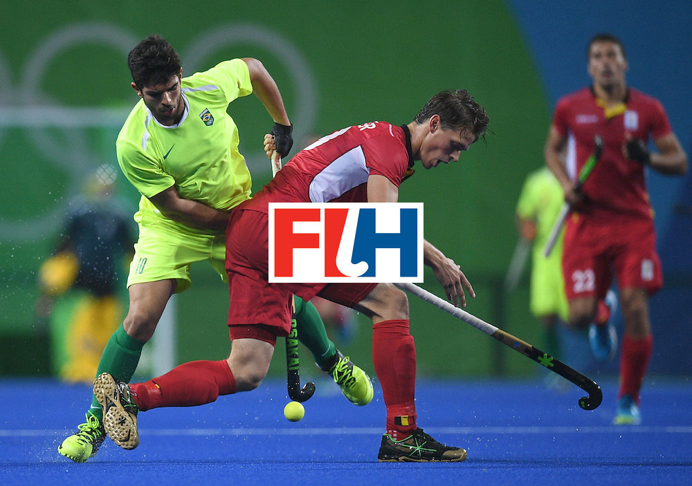 Brazil's Matheus Borges (L) and Belgium's Felix Denayer fight for the ball during the men's field hockey Brazil vs Belgium match of the Rio 2016 Olympics Games at the Olympic Hockey Centre in Rio de Janeiro on August, 7 2016. / AFP / MANAN VATSYAYANA        (Photo credit should read MANAN VATSYAYANA/AFP/Getty Images)
