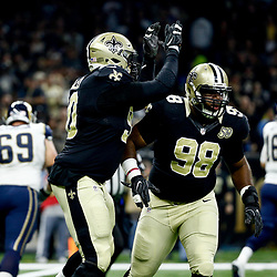 Nov 27, 2016; New Orleans, LA, USA;  New Orleans Saints defensive tackle Sheldon Rankins celebrates with defensive tackle Nick Fairley (90) after forcing a fumble against the Los Angeles Rams during the first quarter of a game at the Mercedes-Benz Superdome. Mandatory Credit: Derick E. Hingle-USA TODAY Sports