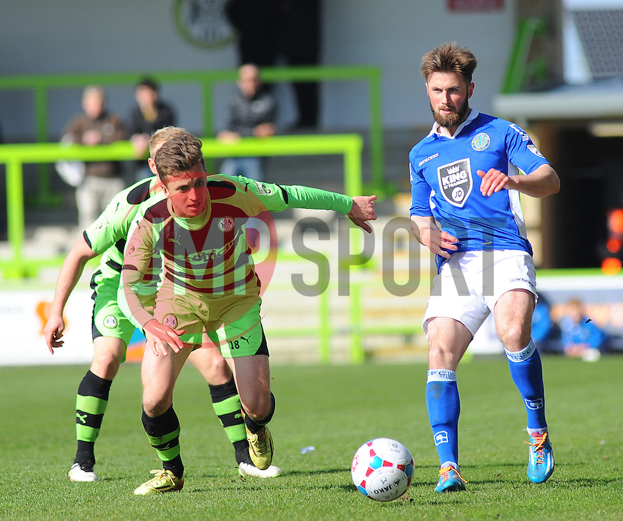Forest Green Rovers's Elliott Frear challenges for the ball against Macclesfield Town's Chris Holroyd. - Photo mandatory by-line: Nizaam Jones - Mobile: 07966 386802 - 11/04/2015 - SPORT - Football - Nailsworth - The New Lawn - Forest Green Rovers v Macclesfield Town - Vanarama Football Conference