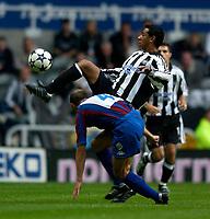 Photo. Jed Wee<br /> Newcastle United v Partizan Belgrade, European Champions League Qualifier, St. James' Park, Newcastle. 27/08/2003.<br /> Newcastle's Nolberto Solano shows good control as Partizan's Igor Duljaj looks on.
