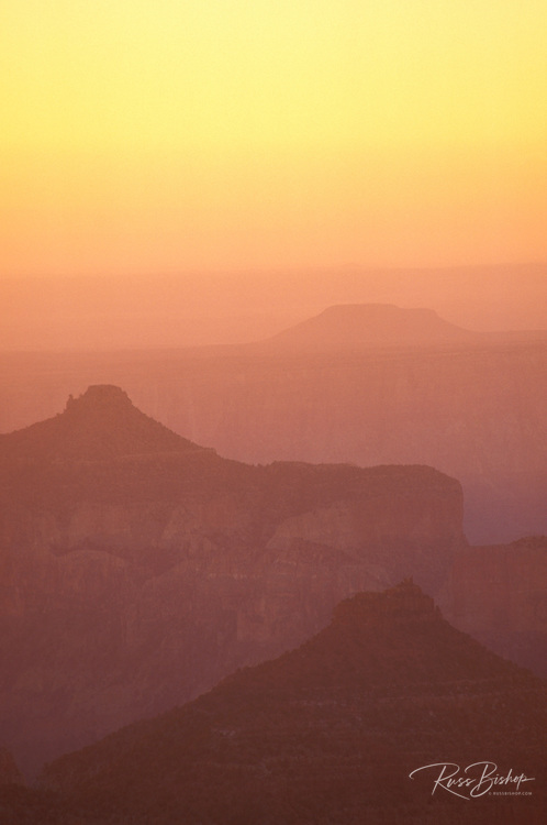 Hazy sunrise over the Grand Canyon from Point Imperial, North Rim, Grand Canyon National Park, Arizona