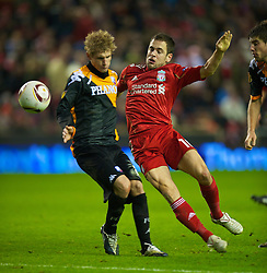 LIVERPOOL, ENGLAND - Wednesday, December 15, 2010: Liverpool's Joe Cole and FC Utrecht's Mihai Nesu during the UEFA Europa League Group K match at Anfield. (Photo by: David Rawcliffe/Propaganda)