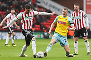 Rotherham United forward Michael Smith (24) and Sheffield United forward Gary Madine (14) battle for the ball during the EFL Sky Bet Championship match between Sheffield United and Rotherham United at Bramall Lane, Sheffield, England on 9 March 2019.