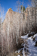 Snow melts from Oak Flat Trail in early spring, in Black Canyon of the Gunnison National Park, near Montrose, Colorado, USA. With two million years to work, the Gunnison River, along with the forces of weathering, has sculpted this vertical wilderness of rock, water, and sky.