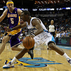 April 24, 2011; New Orleans, LA, USA; New Orleans Hornets point guard Chris Paul (3) drives past Los Angeles Lakers point guard Steve Blake (5) during the fourth quarter in game four of the first round of the 2011 NBA playoffs at the New Orleans Arena. The Hornets defeated the Lakers 93-88.   Mandatory Credit: Derick E. Hingle