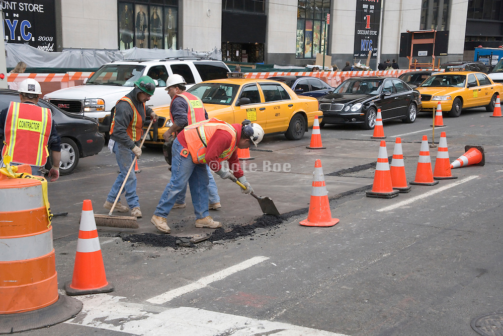 street construction workers making a temporary repair New York City