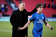 Peterborough Manager Darren Ferguson and Peterborough Utd midfielder Alex Woodyard (4) leave the field after the EFL Sky Bet League 1 match between Doncaster Rovers and Peterborough United at the Keepmoat Stadium, Doncaster, England on 9 February 2019.